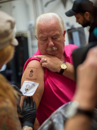 Mick McCarthy pictured getting his tattoo.