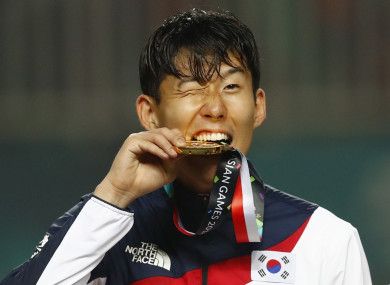 The Tottenham striker pictured with his gold medal on Saturday.