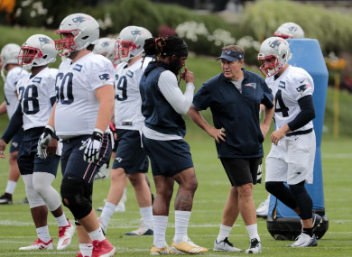 New England Patriots head coach Bill Belichick and his players during a training camp.