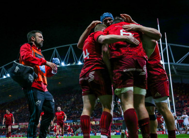 Munster celebrate Peter O'Mahony's try.