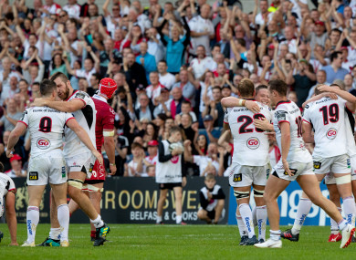 Ulster players celebrate at full-time at Kingspan Stadium.