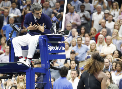 Chair umpire Carlos Ramos talks to Serena Williams after match point after her straight sets defeat to Naomi Osaka of Japan at the US Open Women's Final.