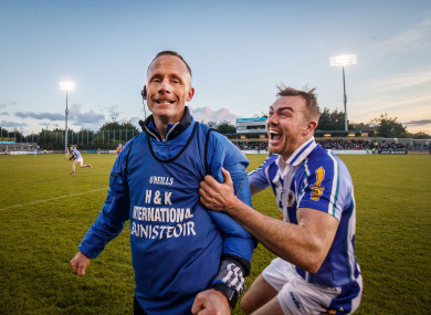 Ballyboden St.Enda's manager Joe Fortune celebrates at the final whistle with Simon Lambert.