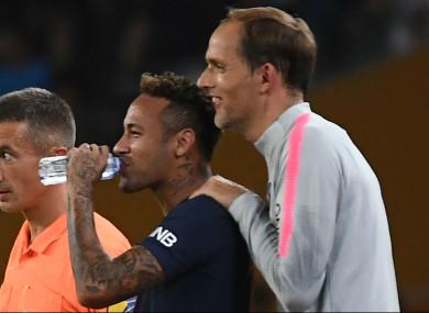 Paris Saint-Germain's Neymar (centre) and coach Thomas Tuchel Tuchel (right)