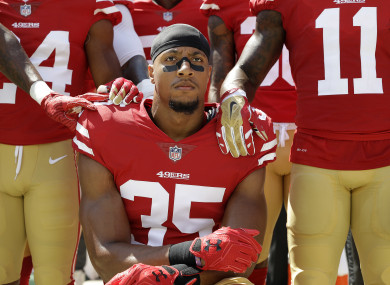 Reid kneeling during the anthem while at the San Francisco 49ers last year.