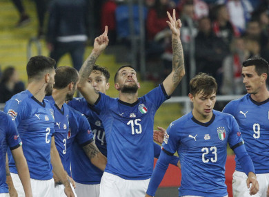 Italy's Cristiano Biraghi, centre, celebrate with his teammates after scoring the winning goal.