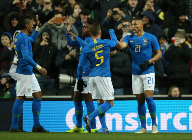 Brazil's Richarlison (right) celebrates scoring his side's first goal of the game.