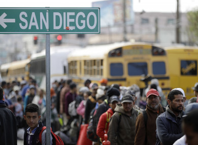 Central American migrants line up for a meal at a shelter in Tijuana, Mexico near the border with California