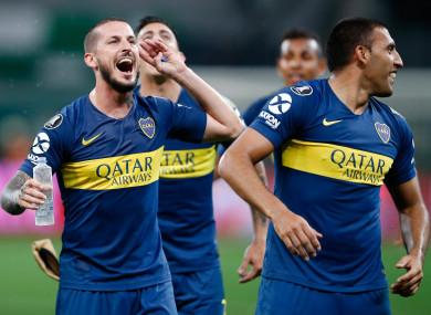 Boca Juniors players celebrate at full-time.