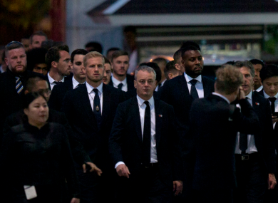 Players and officials from Leicester City arrive at a Buddhist temple to participate in the funeral rituals of Vichai Srivaddhanaprabha in Bangkok, Thailand.