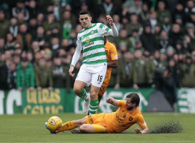 Livingston's Keaghan Jacobs (right) vies with Celtic's Tom Rogic.