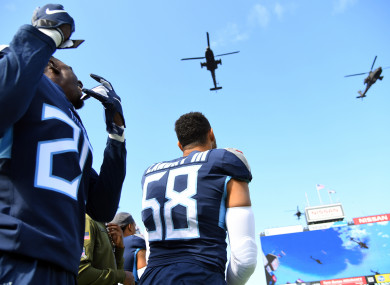 Titans defensive back Kenneth Durden (20) and linebacker Harold Landry (58) watch a flyover by the 101st Airborne before their game against the New England Patriots
