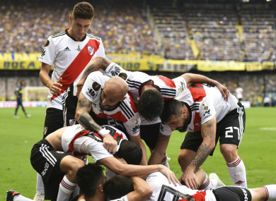 River Plate players celebrate their second equaliser against Boca Juniors.