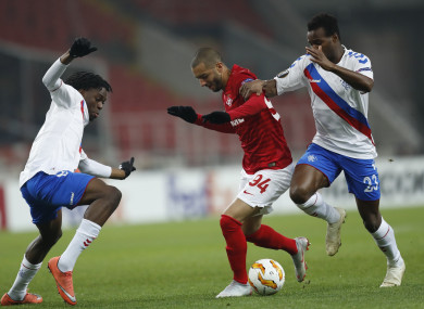 Spartak's Sofiane Hanni, centre, challenges for the ball with Rangers' Lassana Coulibaly, right, and Ovie Ejaria.
