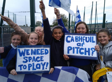 The letters of over 250 children from Gaelscoil Bharra will be handed into the Department of Education today calling for the restoration of their playing field.
