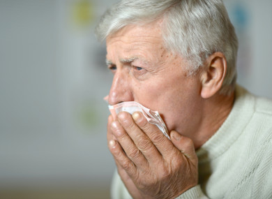 File photo of a man coughing.