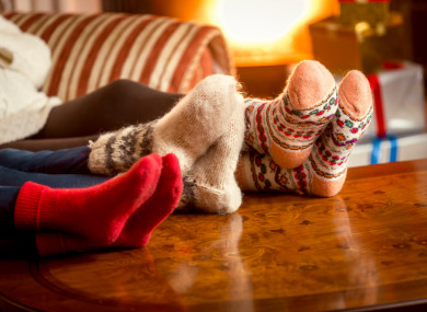 File photo of people with cosy socks sitting on a couch.