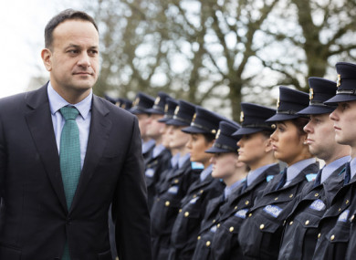Taoiseach Leo Varadkar reviews a trainee guard of honour on his first visit to Templemore Garda Training College in County Tipperary.