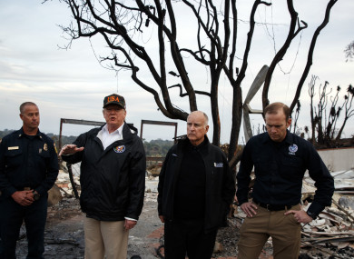 President Donald Trump visits a charred neighborhood impacted by the wildfires.