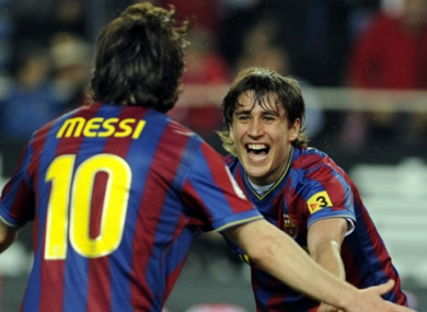 Bojan celebrates a goal with Lionel Messi during their time together at Barcelona.