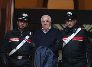 Settimino Mineo, center, who allegedly took over as the Palermo head of Cosa Nostra, is escorted by Italian Carabinieri police after an anti Mafia operation which led the arrest of 46 people including the presumed regional boss.