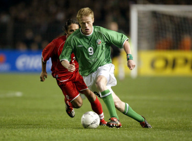 Damien Duff of Ireland and Ricardo Cabanas of Switzerland pictured competing in a Euro 2004 qualifier.