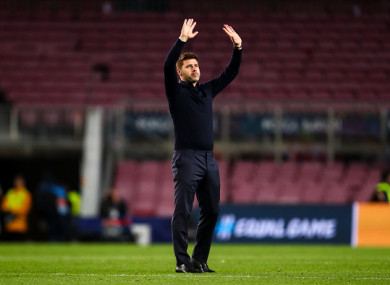 The Tottenham manager salutes the travelling fans last night.