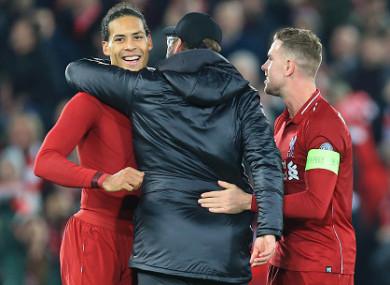 The defender celebrates with Jurgen Klopp and Jordan Henderson last night.