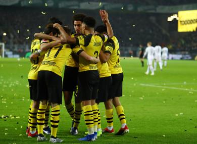 Reus celebrates with his Dortmund team-mates.