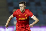 20-year-old Irish defender Masterson named in Liverpool squad for clash with Man Utd