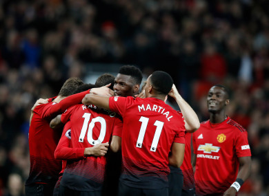 Paul Pogba celebrates with team-mates after giving Man United the lead.