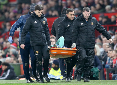 Holding is stretchered off at Old Trafford.