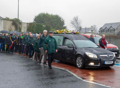 Mourners follow the hearse carrying Stephen Marron's remains in Castleblaney this morning