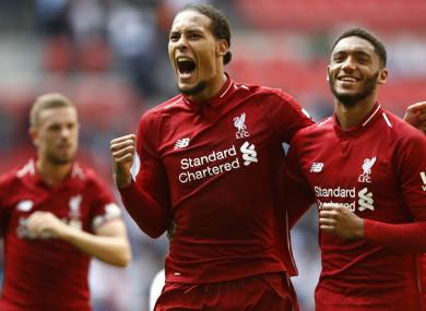 Virgil van Dijk (C) leads Liverpool celebrations.