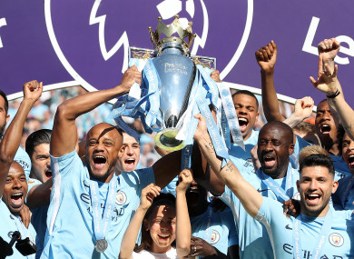 Manchester City lift the Premier League trophy at the end of the 2017/18 season.