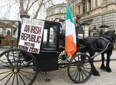 Thomas Clarke with Ronnie O' Brien from Cabra in a replica horse and carriage outside Leinster House.