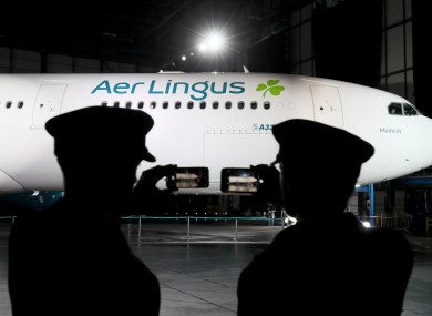 Pilots take photos of an Aer Lingus A330 displaying the new branding during the official unveiling at Dublin Airport.