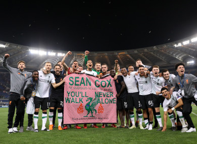 Liverpool players hold aloft a banner in tribute of supporter Sean Cox who remains in serious condition following an assault prior to a Champions League game last year.