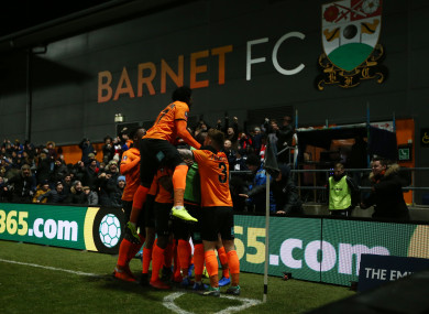 Barnet's Dan Sparkes celebrates scoring his side's third goal.