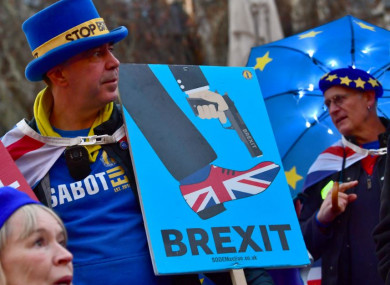 Anti-Brexit protesters outside the Houses of Parliament in London yesterday.