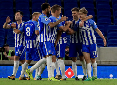 James Tilley (far right) is congratulated by team-mates after scoring the winner for Brighton against Barnet in the Carabao Cup in August 2017.