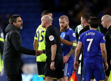 David Wagner (left) and match referee Lee Mason shake hands after the final whistle