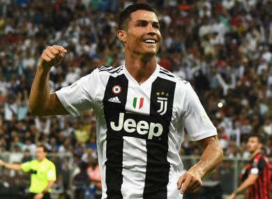 Cristiano Ronaldo celebrates against AC Milan.