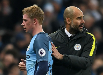 Manchester City's Kevin De Bruyne (left) and Pep Guardiola