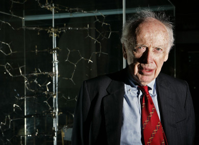 Dr James Watson, who discovered the structure of DNA more than 50 years ago stands next to the original DNA model in 2005