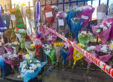 Floral tributes left near the scene in east Belfast where Ian Ogle was murdered on Sunday night.