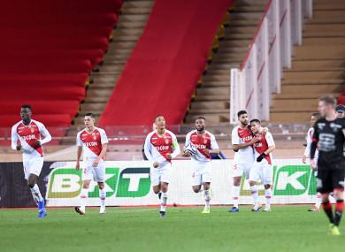 Monaco players celebrate.