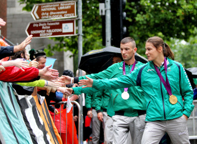 Olympic silver medalist John Joe Nevin and gold medalist Katie Taylor greet Irish fans after the 2012 Games in London.