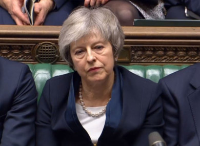 Prime Minister Theresa May listens to Labour leader Jeremy Corbyn speaking after losing a vote on her Brexit deal in the House of Commons, London.