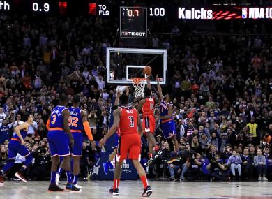 Washington Wizards' Thomas Bryant is fouled as he shoots.
